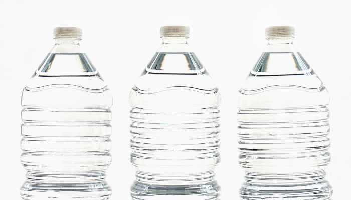 three clear water bottles